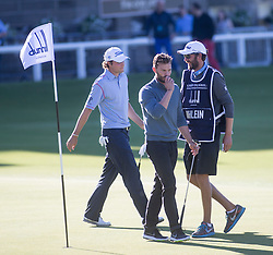 Jamie Dornan kisses the ball after his put at the 18th. Alfred Dunhill Links Championship this afternoon at St Andrews.