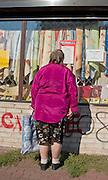 Polish woman age 38 window shopping on Lutomierska Street Balucki District Lodz Central Poland