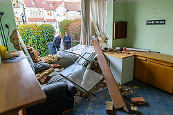 Wreckage clutters the front room of the house at the scene on the corner of Grayscroft Road and  Streatham Vale in South London where a 118 bus crashed into a house on December 26th. The house was empty at the time, the tenants who lived there having a lucky escape as they had vacated the premises on Christmas Eve. LONDON, December 27 2018.