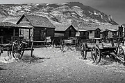 Photographs of Genuine old log cabins and businesses from the Wild West