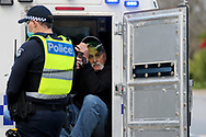 MELBOURNE, VIC - SEPTEMBER 05: Police arrest a man and put him in the back of the van during the Anti-Lockdown Protest on September 05, 2020 in Sydney, Australia. Stage 4 restrictions are in place from 6pm on Sunday 2 August for metropolitan Melbourne. This includes a curfew from 8pm to 5am every evening. During this time people are only allowed to leave their house for work, and essential health, care or safety reasons. (Photo by Dave Hewison/Speed Media)