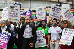 Peter Tatchell, veteran LGBTI+ and human rights campaigner, flanked by Linda Riley and Phyll Opoku-Gyimah, leads thousands of LGBTI+ protesters along Whitehall on the first-ever Reclaim Pride march on 24th July 2021 in London, United Kingdom. Reclaim Pride replaced the traditional Pride in London march, which many feel has become too commercial and strayed from its roots in protest, and was billed as a People's Pride march for LGBTI+ liberation. Campaigners called for the banning of LGBTI+ conversion therapy, the reform of the Gender Recognition Act, the provision of a safe haven for LGBTI+ refugees and for LGBTI+ people to be decriminalised worldwide and marched in solidarity with Black Lives Matter.