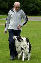 Eddie Sander with his Dogs Jackson and Inka<br /> <br /> 18 June 2004<br /> <br /> Copyright Paul David Drabble<br /> <br /> [#Beginning of Shooting Data Section]<br /> Nikon D1 <br /> <br /> Focal Length: 80mm<br /> <br /> Optimize Image: <br /> <br /> Color Mode: <br /> <br /> Noise Reduction: <br /> <br /> 2004/06/18 09:40:12.5<br /> <br /> Exposure Mode: Manual<br /> <br /> White Balance: Auto<br /> <br /> Tone Comp: Normal<br /> <br /> JPEG (8-bit) Fine<br /> <br /> Metering Mode: Center-Weighted<br /> <br /> AF Mode: AF-S<br /> <br /> Hue Adjustment: <br /> <br /> Image Size:  2000 x 1312<br /> <br /> 1/200 sec - F/7.1<br /> <br /> Flash Sync Mode: Not Attached<br /> <br /> Saturation: <br /> <br /> Color<br /> <br /> Exposure Comp.: 0 EV<br /> <br /> Sharpening: Normal<br /> <br /> Lens: 80-200mm F/2.8<br /> <br /> Sensitivity: ISO 200<br /> <br /> Image Comment: <br /> <br /> [#End of Shooting Data Section]