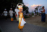 Young girl in traditional Balinese dancers' dress as part of Galungan ceremonies. Galungan celebrates the victory of virtue (Dharma) over evil (Adharma) and is perhaps the most important religious holiday for Balinese Hindus. Sanur, Bali, Indonesia