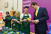 © Licensed to London News Pictures. 27/02/2014. London, UK Nick Clegg helps make a button hole which he later wears. Deputy Prime Minister and Leader of the Liberal Democrats Nick Clegg delivers a speech today, 27th February 2014, on how all young people will be helped to succeed after leaving school. He was speaking to over 500 students at Southfields Academy in South West London. Photo credit : Stephen Simpson/LNP