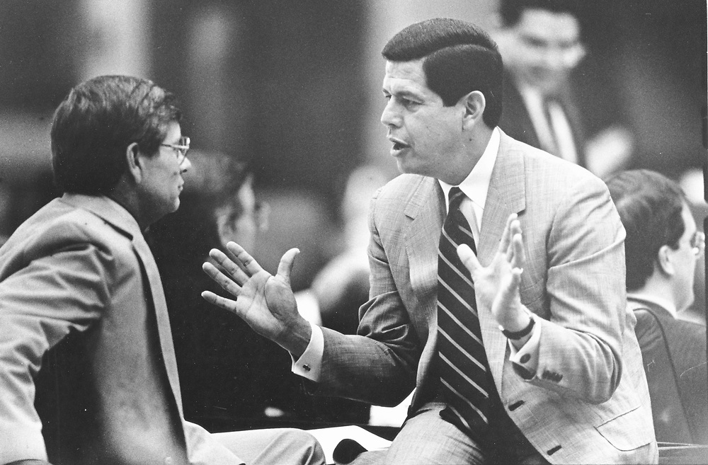 ©1991  Texas House Rep. Hugo Berlanga, D-Corpus Christi, r, talks with Rep. Tom Craddick, R-Midland.