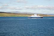 Ferry between Yell and Mainland, passing Bigga island, Shetland Islands, Scotland