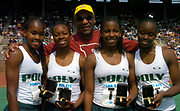 Bill Cosby poses with the Long Beach Poly High (Calif.) girls 4 x 100-meter relay of (from left) Shalonda Solomon, Chanda Picott, Jasminie Lee and Shana Solomon in the 110th Penn Relays at  Franklin Field on Friday, April 23, 2004 in Philadelphia.