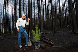 Milt Gillespie, 50 year Pajarito Mountain volunteer, standing in front of his namesake ski run. Las Conchas fire + 7 days.