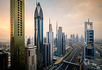 UNITED ARAB EMIRATES, DUBAI - CIRCA JANUARY 2017: Sheikh Zayed Road at sunrise in Dubai. This is the main artery of the city and is home for most of the Dubai skyscrapers.