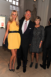 Left to right, POPPY DELEVINGNE and her parents CHARLES & PANDORA DELEVINGNE at a reception to present the new Cartier Tank Watch Collection held at The Orangery, Kensington Palace Gardens, London W8 on 19th April 2012.