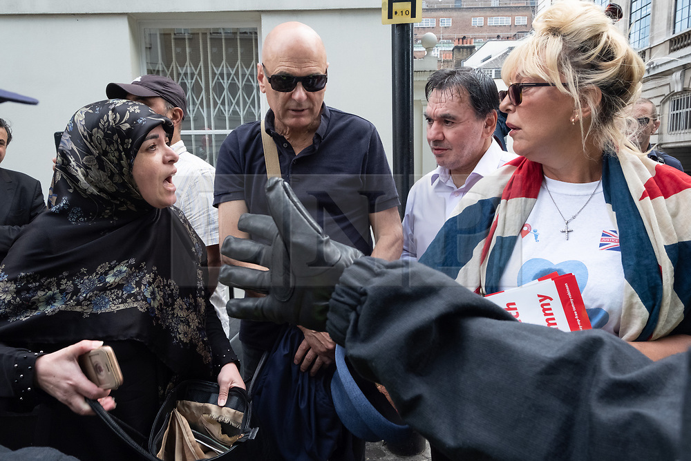 © Licensed to London News Pictures. 10/06/2018. London, UK. A far-right counter demonstrator has a verbal altercation with an un-identified woman the annual Al Quds day march in support of the Palestinian cause. A counter demonstration by far-right and Zionist groups also takes place. Photo credit: Ray Tang/LNP