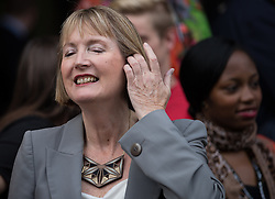 © Licensed to London News Pictures . 20/09/2014 . Manchester , UK . Labour Party deputy leader HARRIET HARMAN in front of the Midland Hotel in Manchester , ahead of the Labour Party Conference . Photo credit : Joel Goodman/LNP