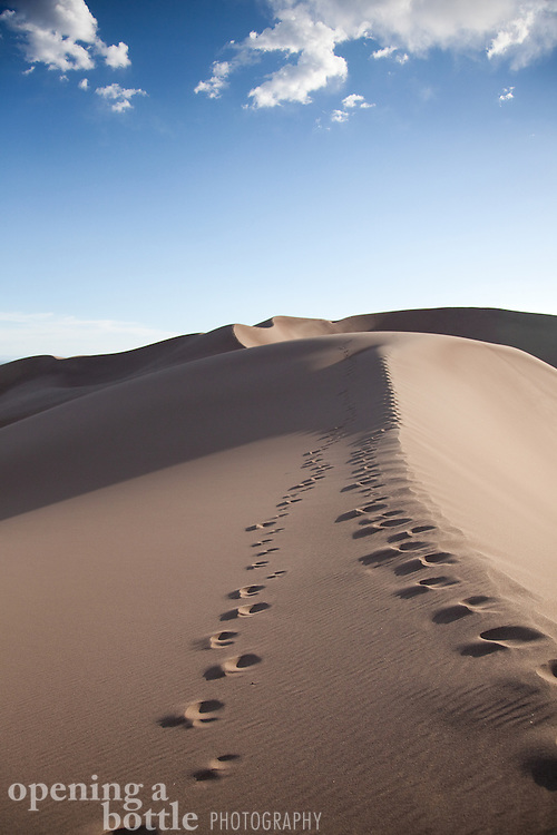 Footsteps climbing the dunes in evening, Great Sand Dunes National Park, Colorado.