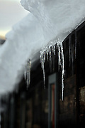 """SHOT 1/10/09 6:05:46 PM - An icicle on a home in Crested Butte, Co. Crested Butte is a Home Rule Municipality in Gunnison County, Colorado, United States. A former coal mining town now called """"the last great Colorado ski town"""", Crested Butte is a destination for skiing, mountain biking, and a variety of other outdoor activities. The population was 1,529 at the 2000 census. The Colorado General Assembly has designated Crested Butte the wildflower capital of Colorado. The primary winter activity in Crested Butte is skiing or snowboarding at nearby Crested Butte Mountain Resort in Mount Crested Butte, Colorado. Backcountry skiing in the surrounding mountains is some of the best in Colorado. The mountain, Crested Butte, rises to 12,162 feet (3,700 m) above sea level..(Photo by Marc Piscotty / © 2009)"""