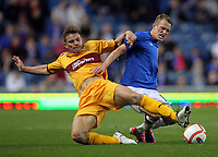 Football - League Cup - Rangers vs Motherwell<br /> <br /> Dean Sheils of Rangers competes with Shaun Hutchinson of Motherwell during Rangers vs Motherwell Communities League Cup Third Round match at Ibrox Stadium, Glasgow.(Ian MacNicol/Colorsport)<br /> <br /> 26th September 2012