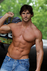 very handsome muscular rugged man without a shirt