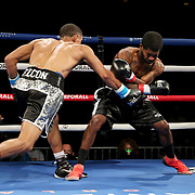 Ofacio Falcon (L) fights Jonathan Gray during a One For All Promotions boxing event at the Caribe Royale Orlando Events Center on Saturday, February 20, 2021 in Orlando, Florida. (Alex Menendez via AP)