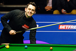 Ronnie O'Sullivan reacts after a shot during his match against Ding Junhui, on day twelve of the Betfred Snooker World Championships at the Crucible Theatre, Sheffield.