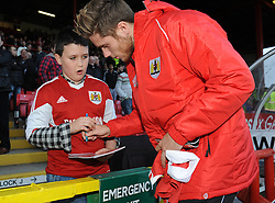 Bristol City's Wes Burns signs an autograph - Photo mandatory by-line: Dougie Allward/JMP - Mobile: 07966 386802 - 01/11/2014 - SPORT - Football - Bristol - Ashton Gate - Bristol City v Oldham Athletic - Sky Bet League One