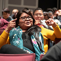 """Talia Boyd, the Western New Mexico organizer with Conservation Voters New Mexico responds to a speech by John Copely, a GMCS high school student at the """"Limb, Life and Bread on Mining in New Mexico Exhibit,"""" Wednesday, Oct. 17, 2018 at the University of New Mexico-Gallup."""