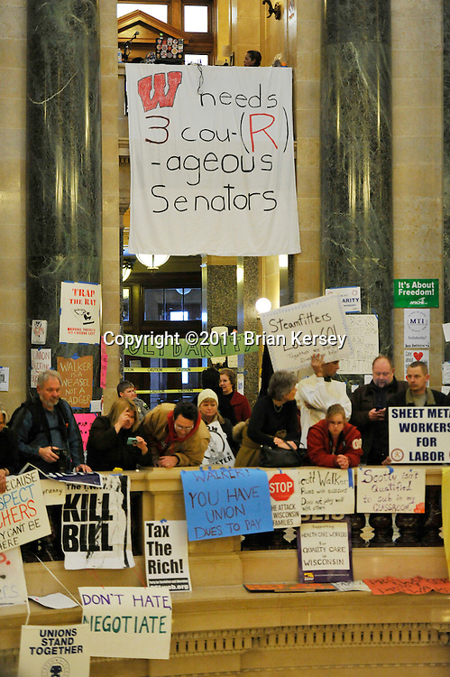 Protesters occupy the state capitol in Madison, Wisconsin on February 23, 2011. The Wisconsin budget proposed by Republican Gov. Scott Walker includes cuts in benefits for state workers and takes away many of their collective bargaining rights.   (Photo by Brian Kersey)