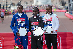 2018?4?22?.     ?????1?2018????????.       4?22???????Vivian Cheruiyot???????.       ???????????2018???????????????Vivian Cheruiyot?2??18?31??????????????.      ????????·????????????? BRITAIN-LONDON-MARATHON 2018.(180422) -- London, Apr. 22, 2018  Medalists Vivian Cheruiyot (C) of Kenya, Brigid Kosgei (L) of Kenya and Tadelech Bekele (R) of Ethiopia pose during the awarding ceremony for the.women's elite group at the London Marathon 2018 in London, Britain on April 22, 2018. Vivian Cheruiyot won the gold with a time of 2 hours 18 minutes and 31 seconds. (Credit Image: © Richard Washbrooke/Xinhua via ZUMA Wire)
