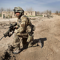 British soldiers of 16 Air Assault Bde's elite BRF (Brigade Reconnaissance Force) provide a security cordon as other troops move from compound to compound searching for weapons and explosives as part of an operation in Helmand Province, Southern Afghanistan on the 15th of March 2011.