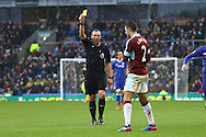 Matthew Lowton of Burnley receives a yellow card from referee Kevin Friend. Premier league match, Burnley v Chelsea at Turf Moor in Burnley, Lancs on Sunday 12th February 2017.<br /> pic by Chris Stading, Andrew Orchard Sports Photography.