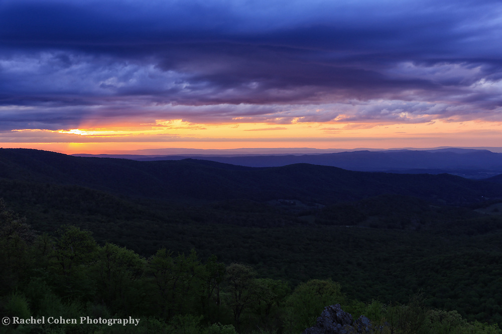 """""""Day is Done Gone the Sun""""<br /> <br /> The end to a beautiful day over the Shenandoah Valley. Lovely clouds and colors above the ridges!!<br /> <br /> The Blue Ridge Mountains by Rachel Cohen"""