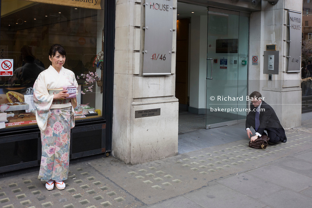 A geisha lady collects money from westerners in London for the Japanese Red Cross Tsunami appeal