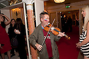 NIGEL KENNEDY, The South Bank Sky Arts Awards , The Dorchester Hotel, Park Lane, London. January 25, 2011,-DO NOT ARCHIVE-© Copyright Photograph by Dafydd Jones. 248 Clapham Rd. London SW9 0PZ. Tel 0207 820 0771. www.dafjones.com.