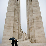 The twin white pylons of the Canadian National Vimy Memorial dedicated to the memory of Canadian Expeditionary Force members killed in World War one. The monument is situated at a 100 hectare preserved battlefield with wartime tunnels, trenches, craters and unexploded munitions. The memorial designed by Walter Seymour Allward opened in 1936.