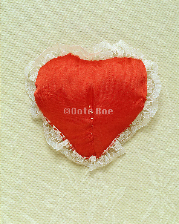 mended heart cushion
