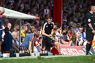 Marinus Dijkhuizen, the Brentford head coach (c) looks on from the dugout. Skybet football league Championship match, Brentford v Ipswich Town at Griffin Park in London on Saturday 8th August 2015.<br /> pic by John Patrick Fletcher, Andrew Orchard sports photography.