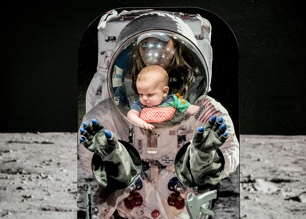 """Visitors at the Smithsonian's """"Destination Moon"""" traveling exhibit, St. Louis, Missouri, 2018.  Exhibit currently at the Museum of Flight in Seattle, Washington.<br /> Photo by Tom Reese."""