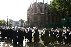 © Licensed to London News Pictures. 01/10/2019. London, UK. Judges leave Westminster Abbey for The Houses of Parliament after attending the annual service to mark the start of the legal year. The start of the new legal year is marked with a traditional religious service in Westminster Abbey followed by a procession to The Houses of Parliament where the Lord Chancellor hosts a reception.  Photo credit: Dinendra Haria/LNP