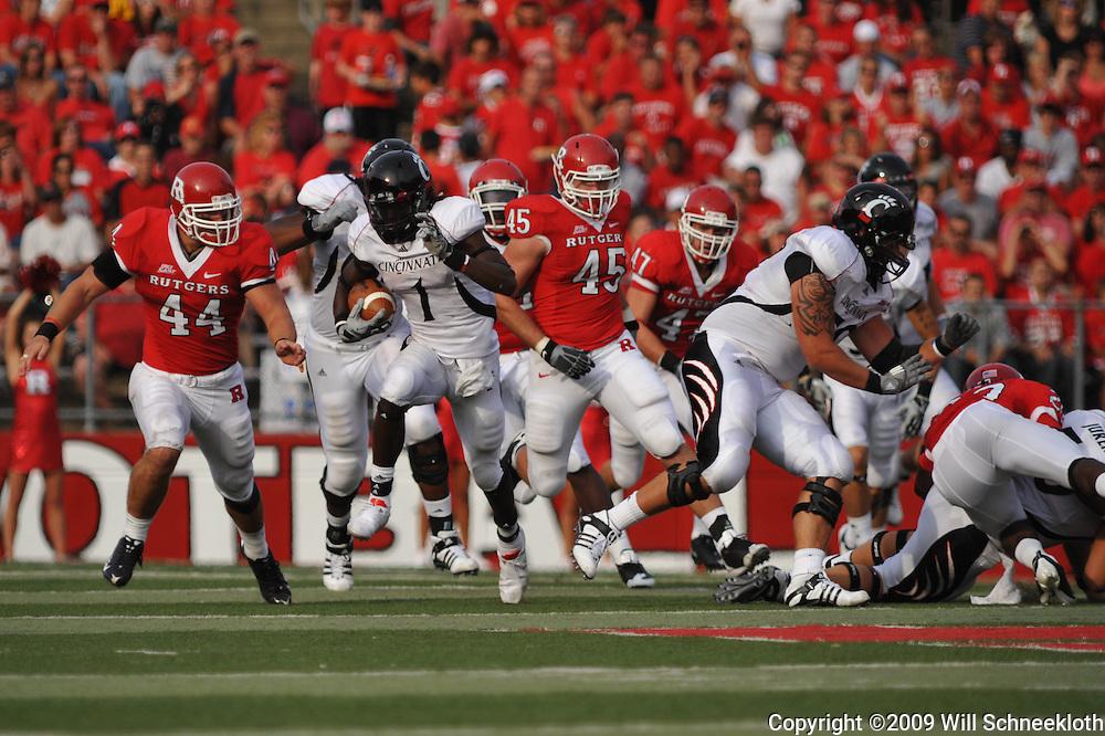 Sep 7, 2009; Piscataway, NJ, USA; Cincinnati wide receiver Marshwan Gilyard (1) avoids tacklers during the first half of Rutgers 47-15 loss to Cincinnati in NCAA college football at Rutgers Stadium.