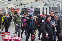 "St Pancras, London, January 16th 2016. Dozens of protesters hold an ""emergency demonstration and die-in"" as France prepares to bulldoze the Jungle Camp at Calais. PICTURED: Protesters march from Kings Cross Square towards the main entrance of the Eurostar terminal at St Pancras.///FOR LICENCING CONTACT: paul@pauldaveycreative.co.uk TEL:+44 (0) 7966 016 296 or +44 (0) 20 8969 6875. ©2016 Paul R Davey. All rights reserved."