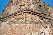 Close up of two sphinxes relief scul[ptures of the Phrygian temple of Aslankaya, 7th century BC. Phyrigian Valley, Emre Lake, near Doger, Turkey.<br /> <br /> On the triangular roof over the facade are two sphinxes (winged figures with the head of a human and the body of a lion), facing one another, take place. In the main facade, below, the sphinxes in a niche, a cult statue of Kybele or the Great Mother (vandalised and destroyed) was flanked by two lions. This main facade is ornamented with relief geometrical patterns. .<br /> <br /> If you prefer to buy from our ALAMY PHOTO LIBRARY  Collection visit : https://www.alamy.com/portfolio/paul-williams-funkystock/aslankaya-temple-turkey.html<br /> <br /> Visit our TURKEY PHOTO COLLECTIONS for more photos to download or buy as wall art prints https://funkystock.photoshelter.com/gallery-collection/3f-Pictures-of-Turkey-Turkey-Photos-Images-Fotos/C0000U.hJWkZxAbg
