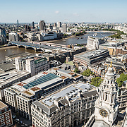 London's skyline as seen from the top of the dome of St Paul's Cathedral. In the top left is the Thames.