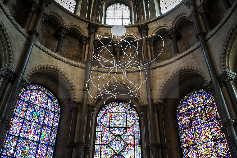 © Licensed to London News Pictures. 24/05/2018. Canterbury, UK.  Baldwin & Guggisberg's painted steel sculpture 'Unite, Diversite, Egalitie, 2018' is displayed in The Corona at Canterbury Cathedral. A series of glass installations by artists Philip Baldwin and Monica Guggisberg reflecting on themes of war and remembrance, migration and refugees are going on display at the cathedral commemorating the 100th anniversary of the end of the First World War. Under an Equal Sky will take visitors on a journey that begins with the Boat of Remembrance in the Nave and ends with a glass wall of multi-coloured vessels in The Crypt . Photo credit: Peter Macdiarmid/LNP