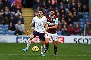Everton's Leighton Baines being chased by Burnley's George Boyd. Barclays Premier league match, Burnley v Everton at Turf Moor in Burnley, Lancs on Sunday 26th October 2014.<br /> pic by Chris Stading, Andrew Orchard sports photography.