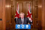 Mcc0098301. Daily Telegraph<br /> <br /> DT News<br /> <br /> Boris Johnson led the Virtual Press Conference inside Downing street this evening flanked by Professor Jonathan Van-Tam and Professor Steve Powis .<br /> <br /> London 30 December 2020