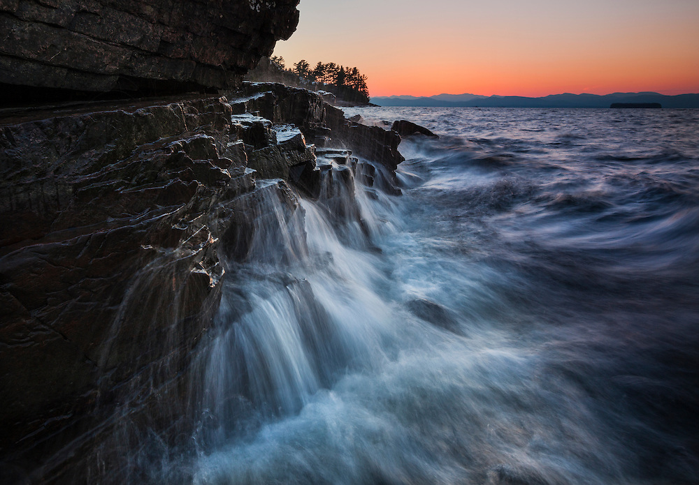 Waves crashing against the rocky shore of Lake Champlain, Oakledge Park, Vermont