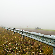 Highway passing through countryside with crash barrier