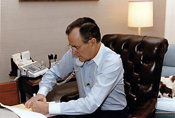 United States President George H.W. Bush speaks by telephone to US Secretary of State James A. Baker, III after the Secretary's first meeting with Foreign Minister Tariq Aziz of Iraq at the White House in Washington, DC on January 9, 1991. Photo by Carol T. Powers / White House via CNP/ABACAPRESS.COM