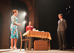 © Licensed to London News Pictures. 23/04/2012. London, England. Anna Chancellor as Belinda Duffield, Jonathan Bailey as Jeremy Duffield and Alex Lawther as John Blakemore. Actors Anna Chancellor and  Nicholas Farrell star in a double bill - South Downs by David Hare, directed by Jeremy Herrin and The Browning Version by Terence Rattigan, directed by Angus Jackson at the Harold Pinter Theatre. Photo credit: Bettina Strenske/LNP
