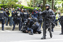 June 4, 2017 - Portland, Oregon, United States - Portland, Oregon: Portland police arrest a protestor at the Trump Free Speech Rally Portland. Organized by Joey Gibson, a leader of the Patriot Prayer group, the rally in downtown Portland featured right-wing nationalist Kyle Chapman and speakers in support of free speech and President Trump. (Credit Image: © Paul Gordon via ZUMA Wire)
