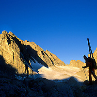MOUNTAINEERING. Michael Graber (MR) by Palisade Glacier (Sierra Nevada, CA). Thunderbolt Peaks (L) & Mt. Winchell bkg. John Muir Wild.